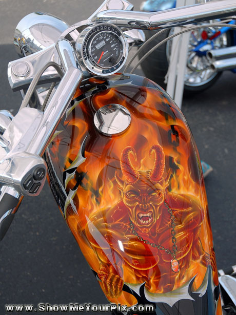 A demon stares from a custom chopper displayed by American Classic Cycles at the Colonial Mall.