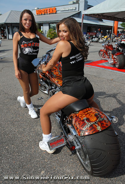 Hooters girls April and Lauren pose with a custom Big Dog bike by the Myrtle Beach Hooters restaurant.